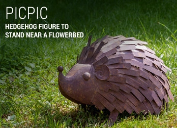 Hedgehog figure to stand near a flowerbed